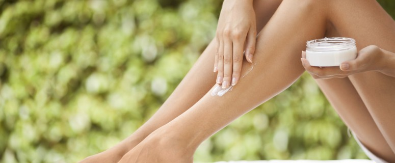 Beautiful Woman Legs And Cream.